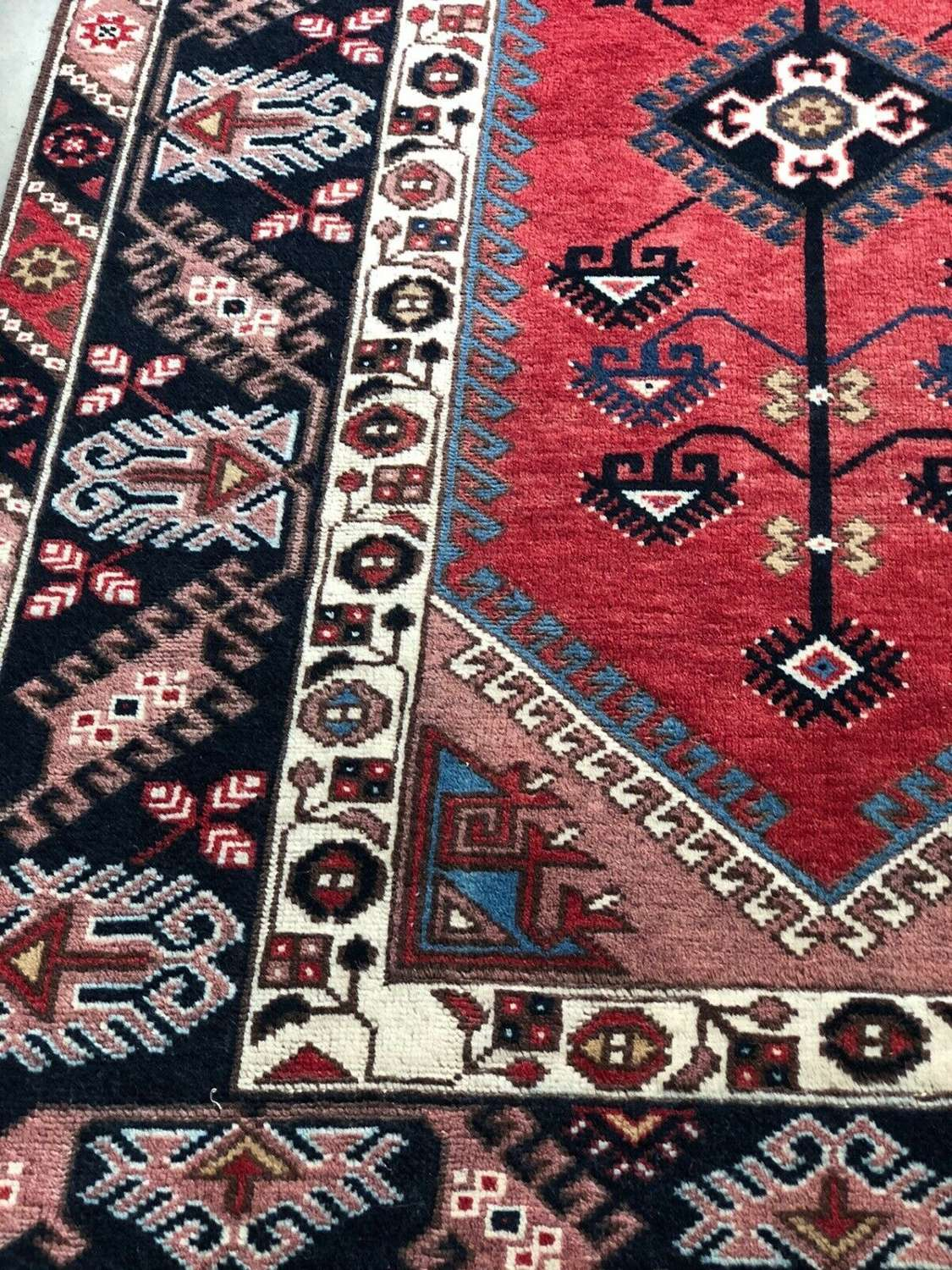 Red ground persian rug
