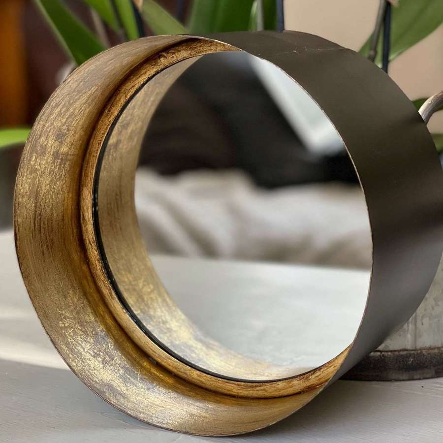 Antique style deep rim gold and black mirror.