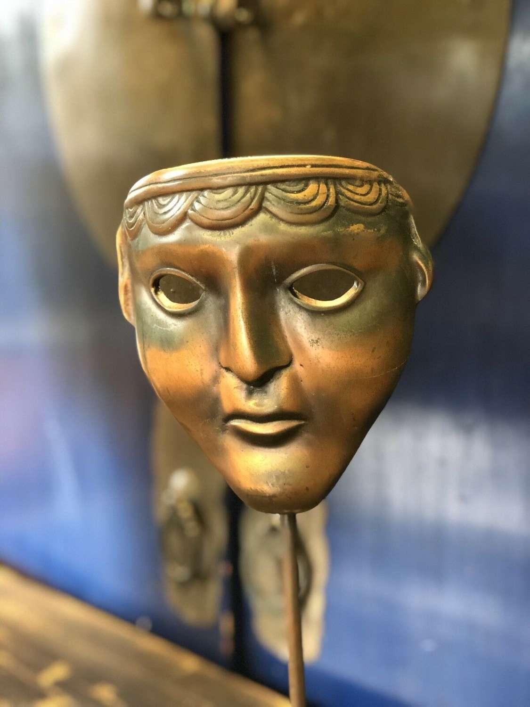 Greek tragedy mask in brass