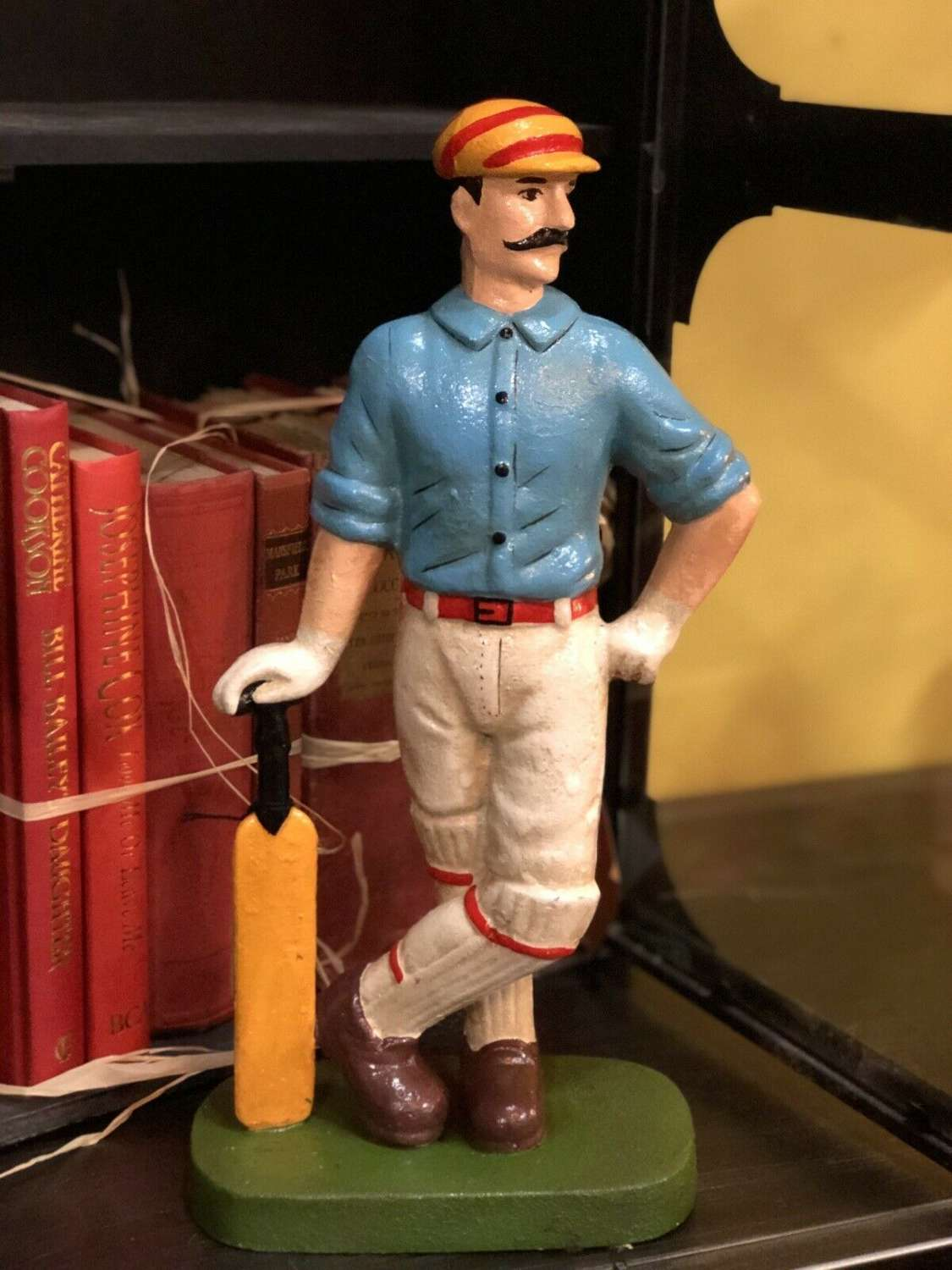 Cast Iron cricketer door stop