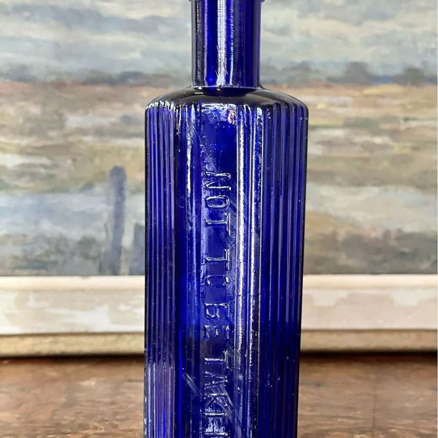 Victorian blue glass apothecary bottle