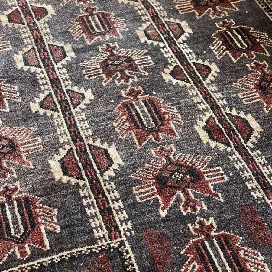 Vintage hand knotted Kazak rug