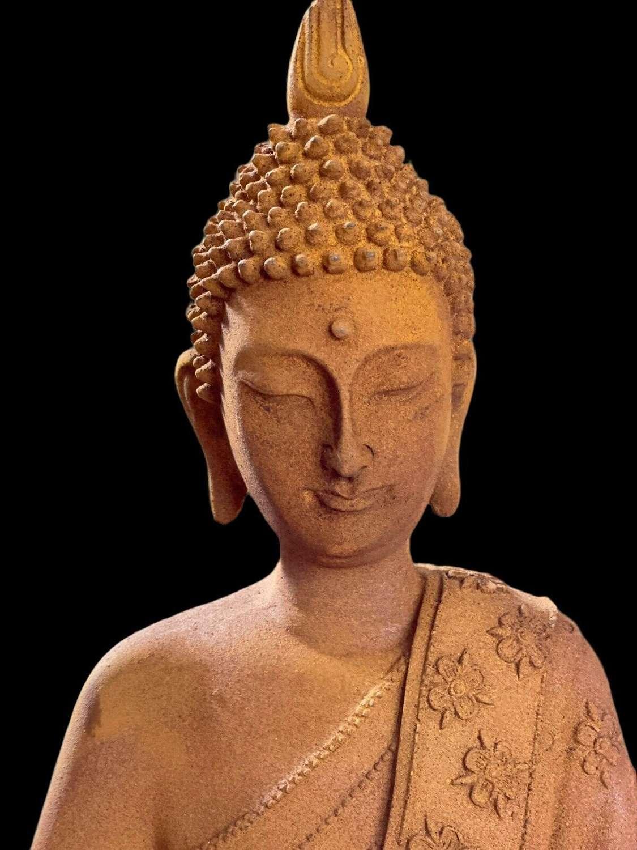 Rusty iron Buddha statue